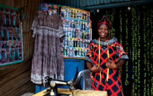 In Juba town in South Sudan, a client of Finance South Sudan Limited, one of MicroLead's grantees, has been able to increase her tailoring works and income as a result of loans. ©