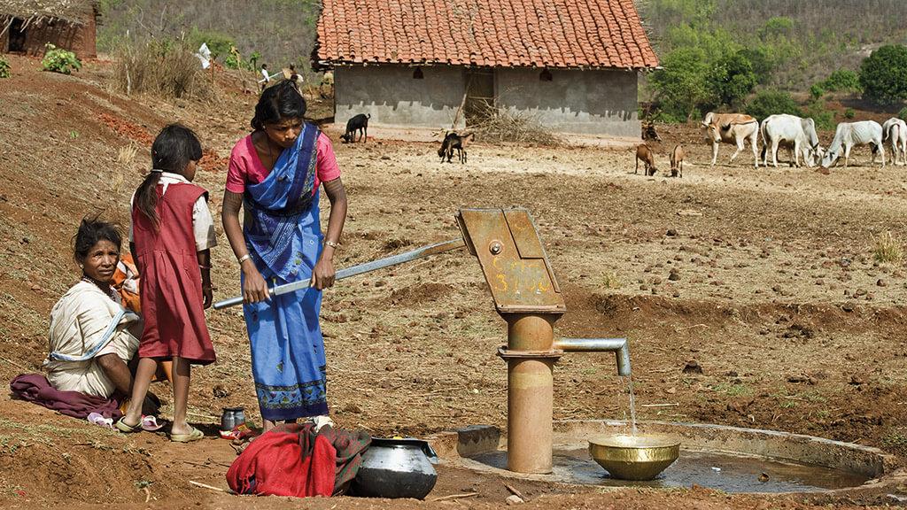 India - Women Pumping Water