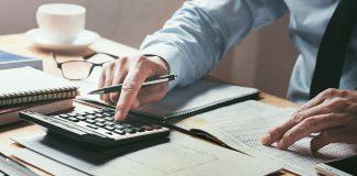 Hands, calculator, paperwork