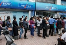 Queue outside a branch of Yes Bank