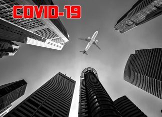 Skyscrapers with aircraft in sky