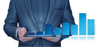 Illustration: Businessman holding tablet with barchart