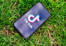 Tik Tok app on phone, grass background