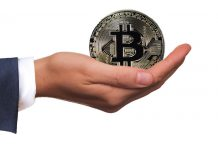 Hand holding Bitcoin, giving, donation, charity