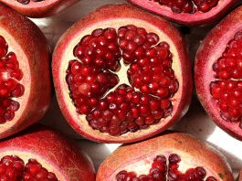 Pomegranate fruit, cut open to show seeds