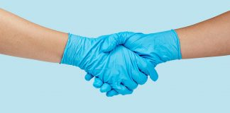 Shaking hands with blue latex gloves (Image by rawpixel.com)