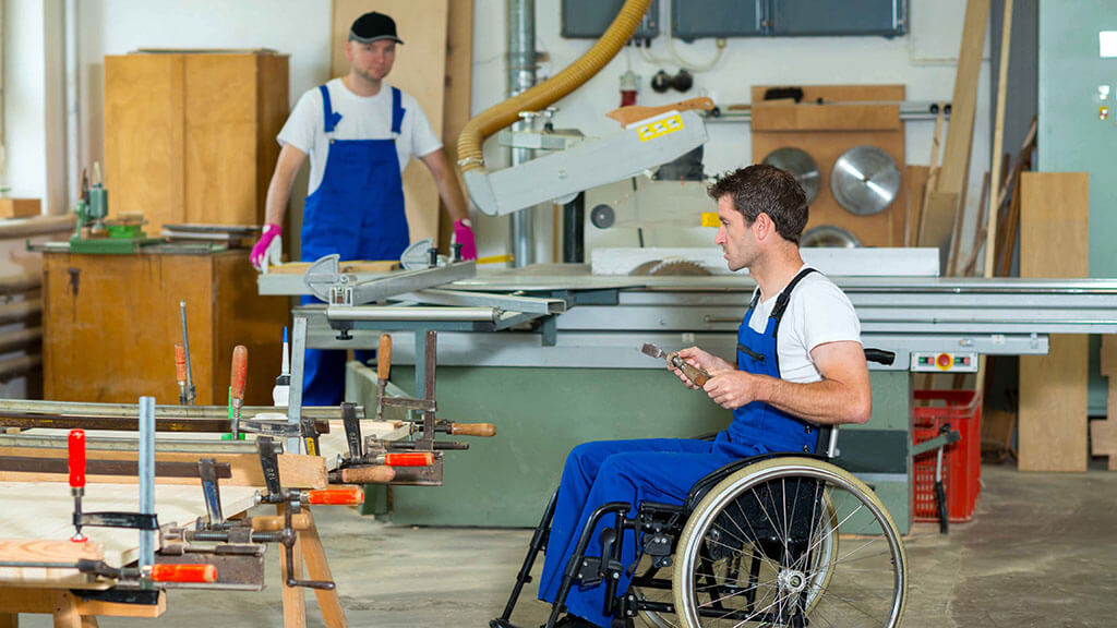 Man with disability working in factory