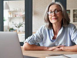 Older businesswoman behind desk